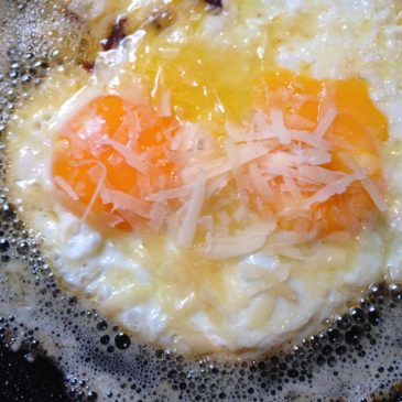Butter Soaked Chillied Eggs with Parmesan by M. Kuehn